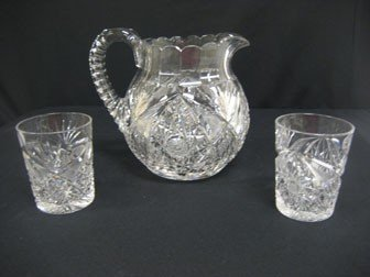 29: Cut glass signed Libbey Corinthian bulbous pitcher