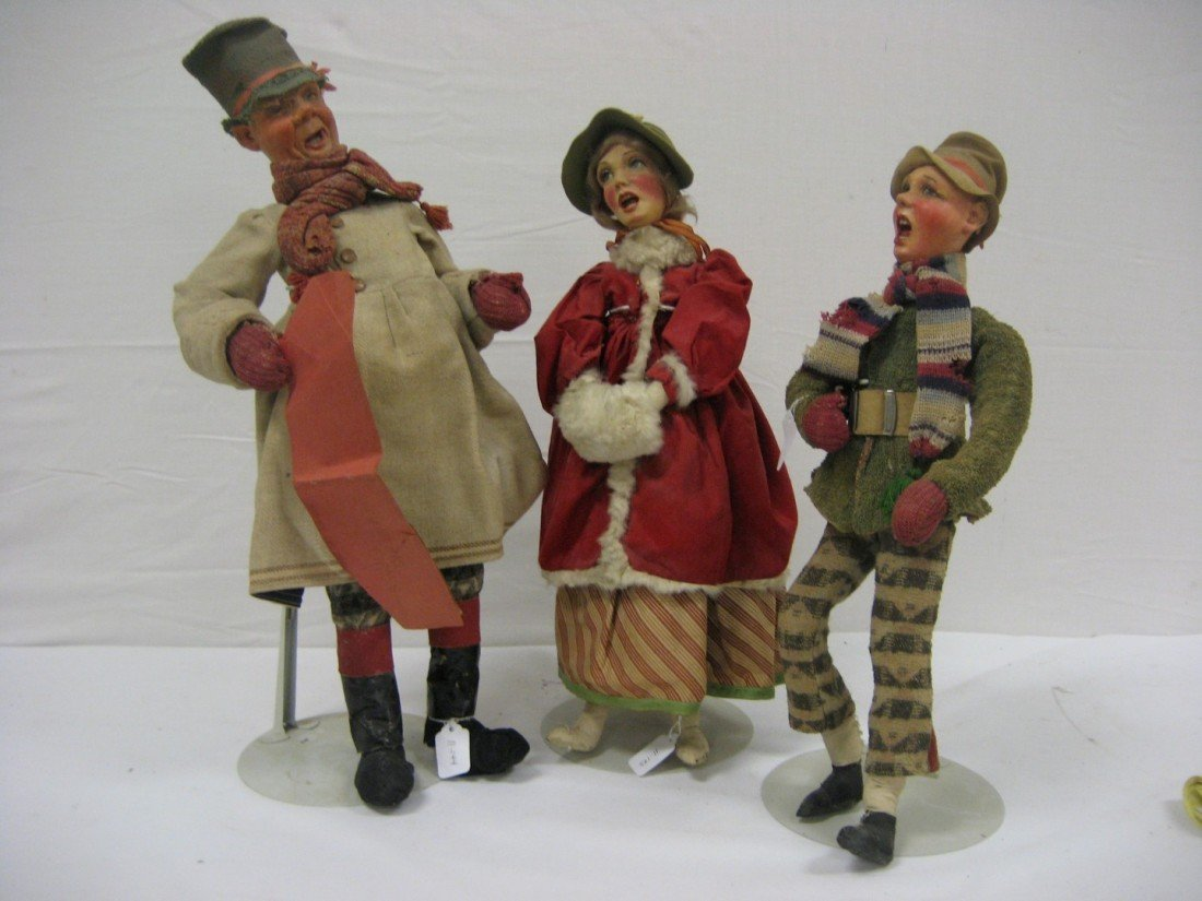 18: Grouping of carolers.  Cloth body with papier mache