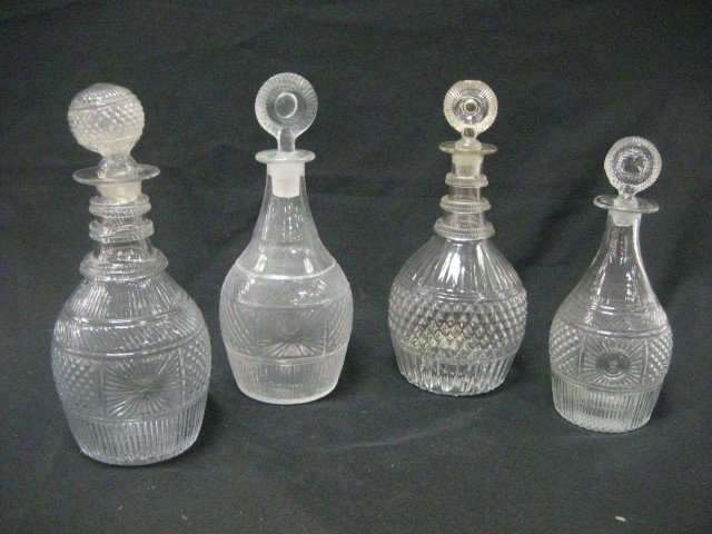 "2: Four (4) molded decanters:  10 1/2"" with ringed neck"