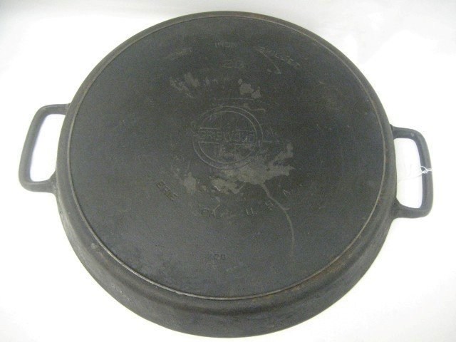 "15: Griswold ""20"" 728 cast iron skillet with rim nick"