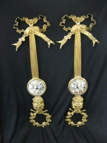 14A: Pair of molded brass wall sconces with satyr head,