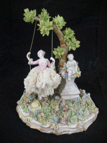 89: Fabris Italian porcelain figure of a lady in a gard