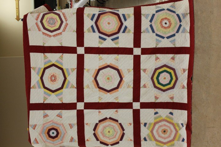 14: Nine panel 8-point star quilt with red border, mino