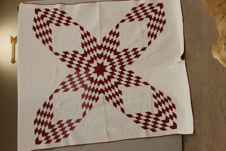 15: Star propeller quilt with fine quilting, minor stai