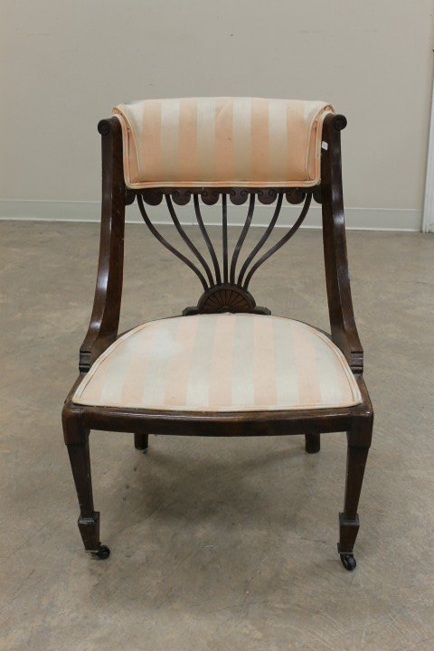 Walnut/rosewood carved back chair with shield seat.  Mi