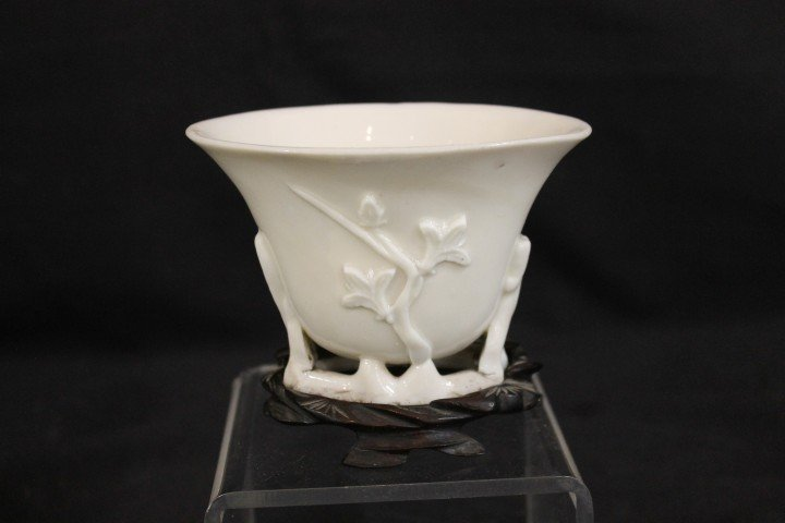 Unmarked porcelain libation cup on signed base.  Cup wi