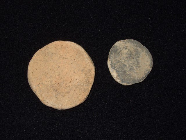 Two game stones.  Largest is 2 1/4""
