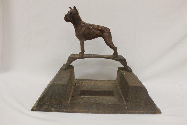 Iron door stop/boot scraper with boxer dog on top.  18