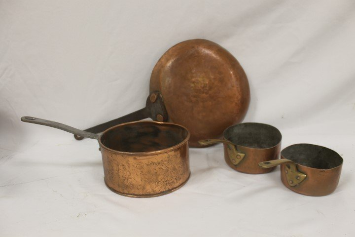 Copper pans with brass and metal handles.  Largest is 4