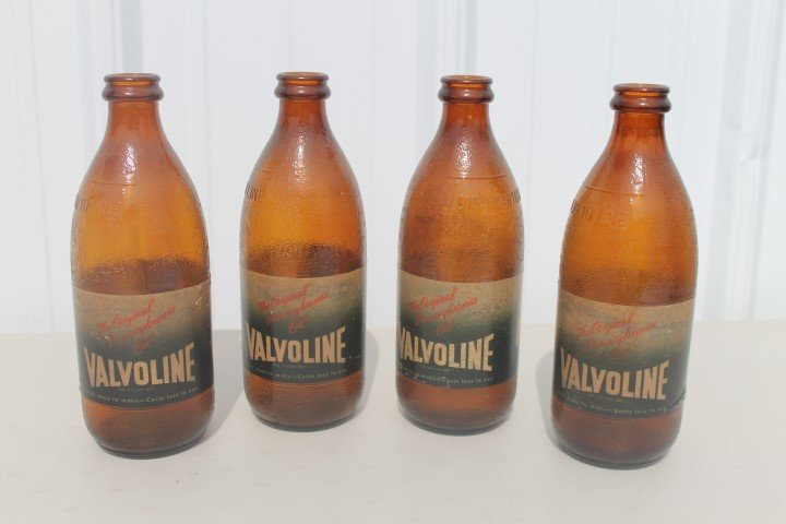 (4) Valvoline aber 1-quart motor oil jars, no caps.