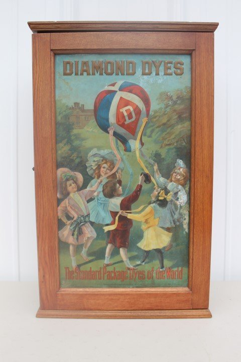 Diamond Dye cabinet with embossed tin showing children