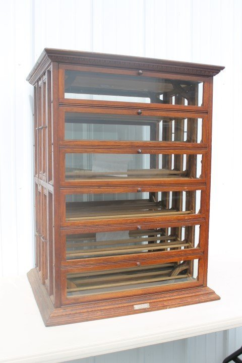 A.N. Russell &  Sons oak ribbon cabinet with 4 rows and