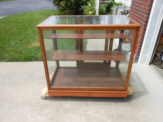 "Small floor model oak showcase, 37 1/2"" tall, 41 1/4"""