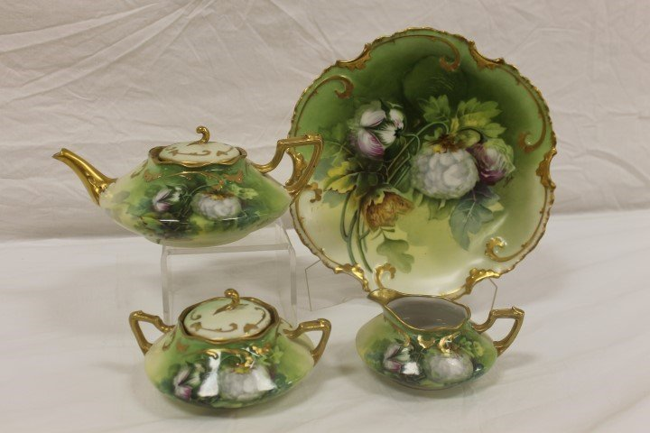 Limoges tea set decorated in the King Cotton pattern,