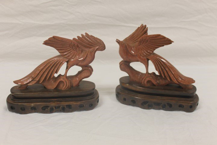Pair of carved birds on fitted stands.  Black veining