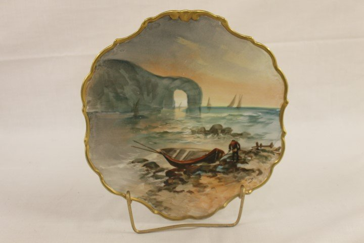 "Limoges 9 7/8"" plate with sea shore scene with a man"