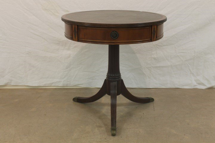 Walnut drum table with two drawers and reeded tri-pod
