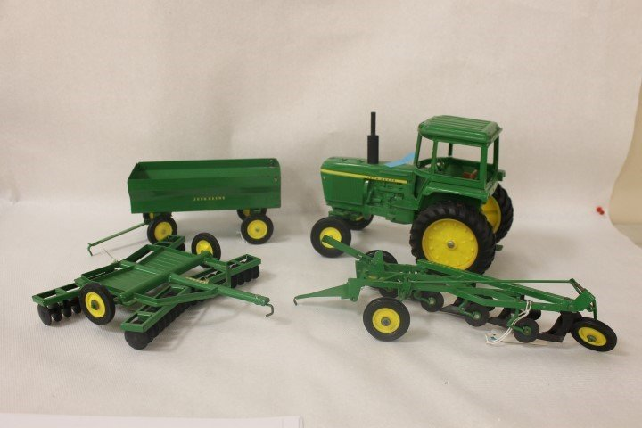 Ertl John Deere 4430 with Wagon, Plow and Disc.