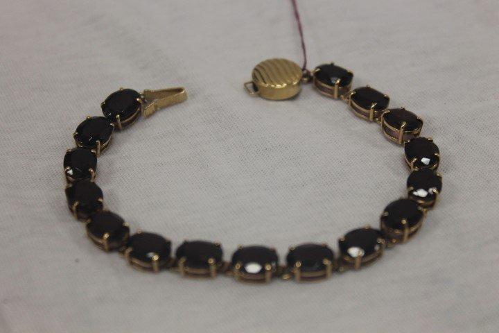 14k yellow gold ladies rhodolite garnet bracelet with