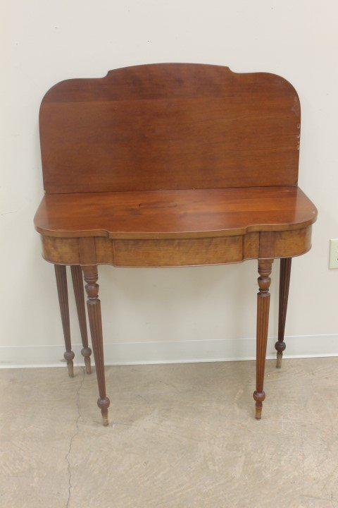 Cherry block front game table with reeded legs.  35