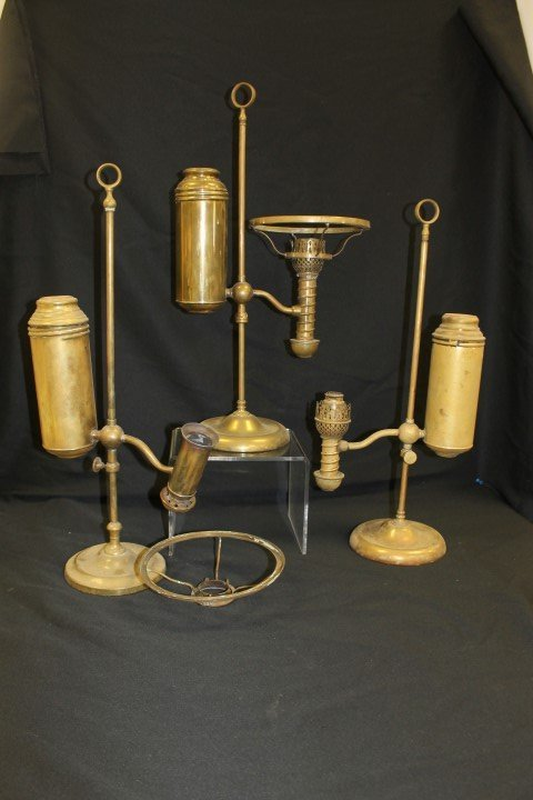 """Brass student lamps, one with damage, 20 1/2"""" tall,"""