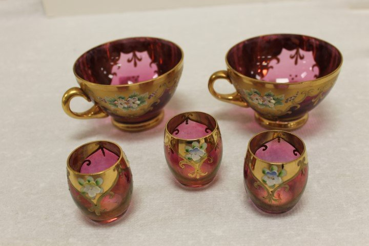 Cranberry enameled gold decorated Moser style glass