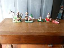 11 Folk Art clay or plaster figures some marked Tim