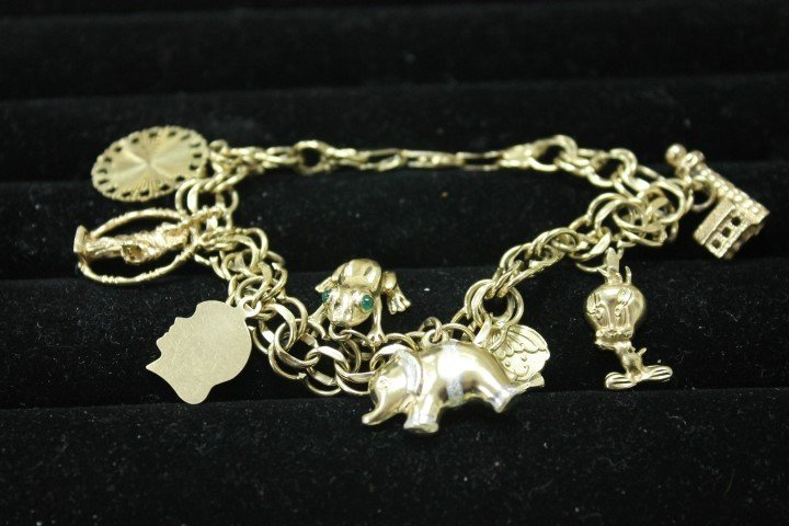 14K yellow gold charm bracelet with charms:  light