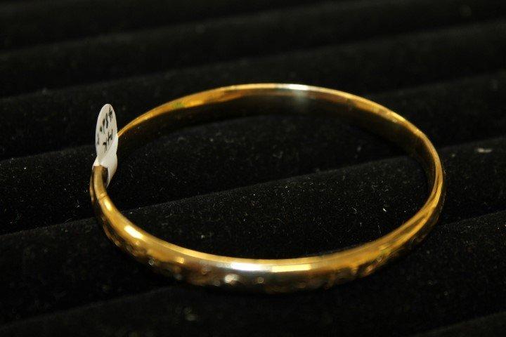 14K yellow gold bangle bracelet marked B.A.B.