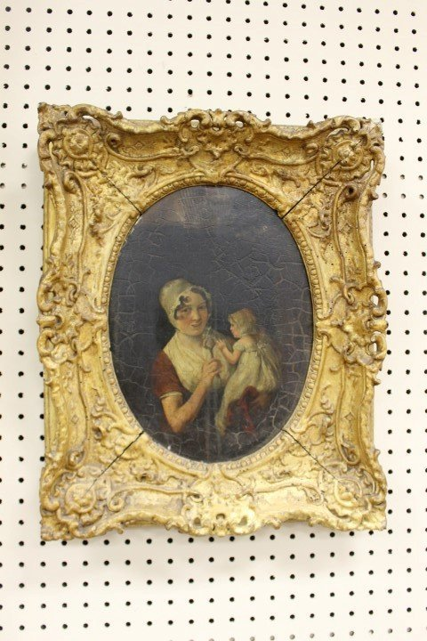 Oval oil on board framed portrait of a lady and child