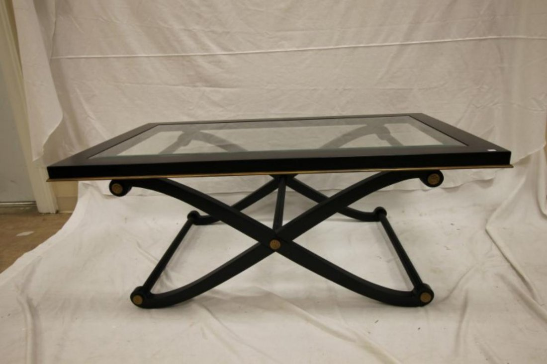 Black Regency-style coffee table with glass top insert,