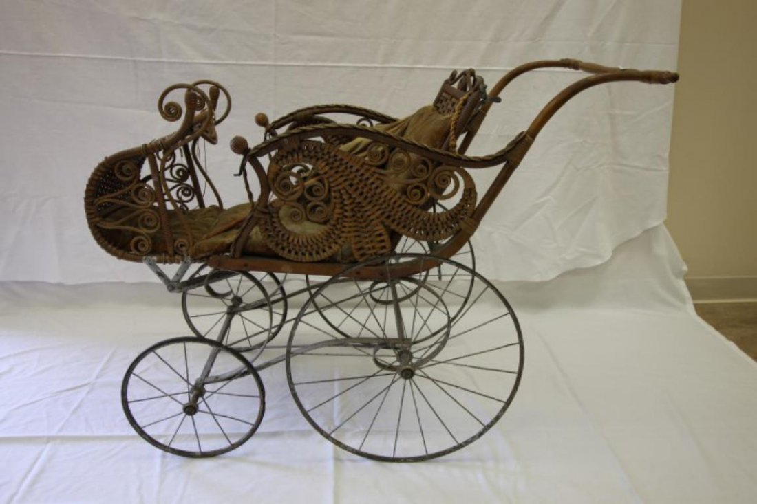 Early wicker pram with umbrella.  Minor loss and wear,