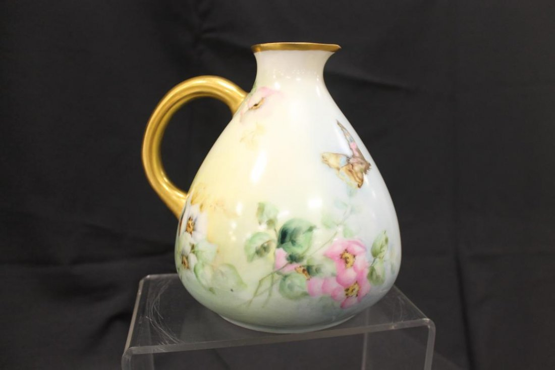 "Bavaria 7"" bulbous ewer with gold handles and rim, with"
