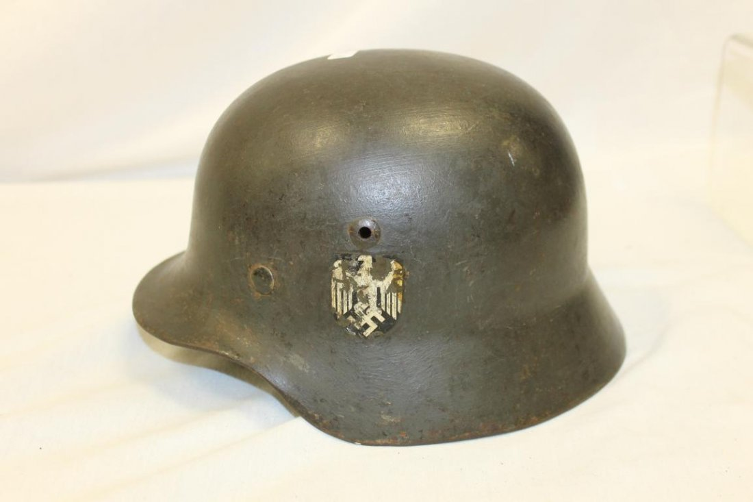 World War 2 German Army helmet with nazi decal on side.