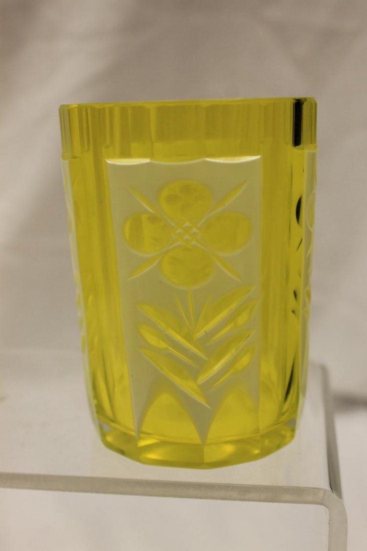 White cut-to-canary tumbler with illegible base mark.