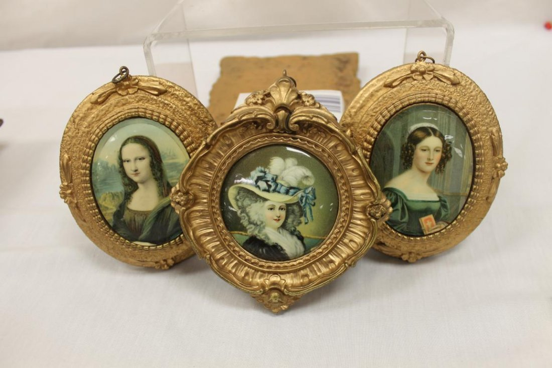 "Cameo portraits:  (2) oval 5 1/4"" wooden frame"