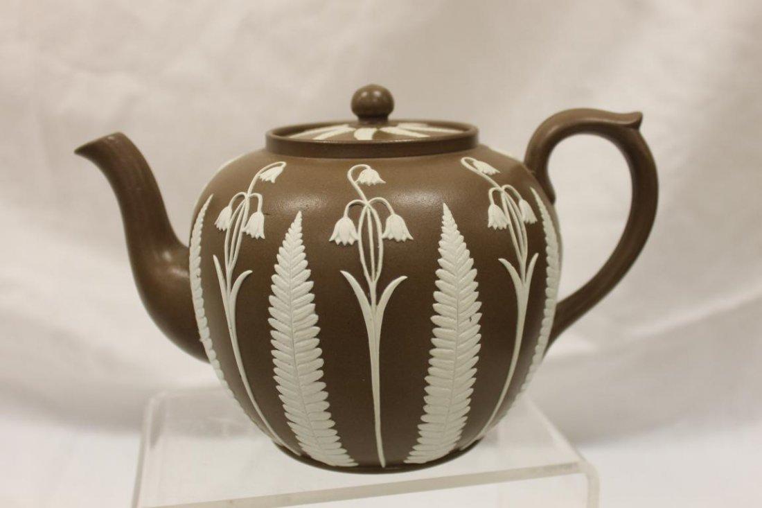 "Early brown jasperware teapot, app. 5 1/2"" tall."
