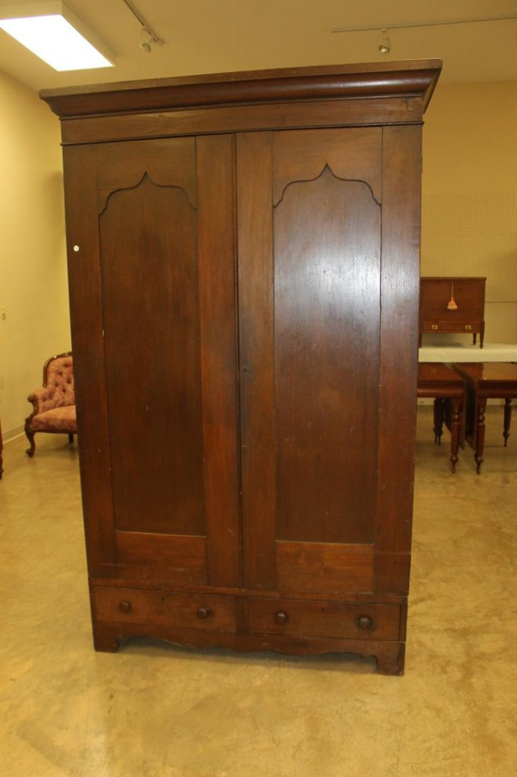 Walnut wardrobe with two doors over t drawers.  Solid