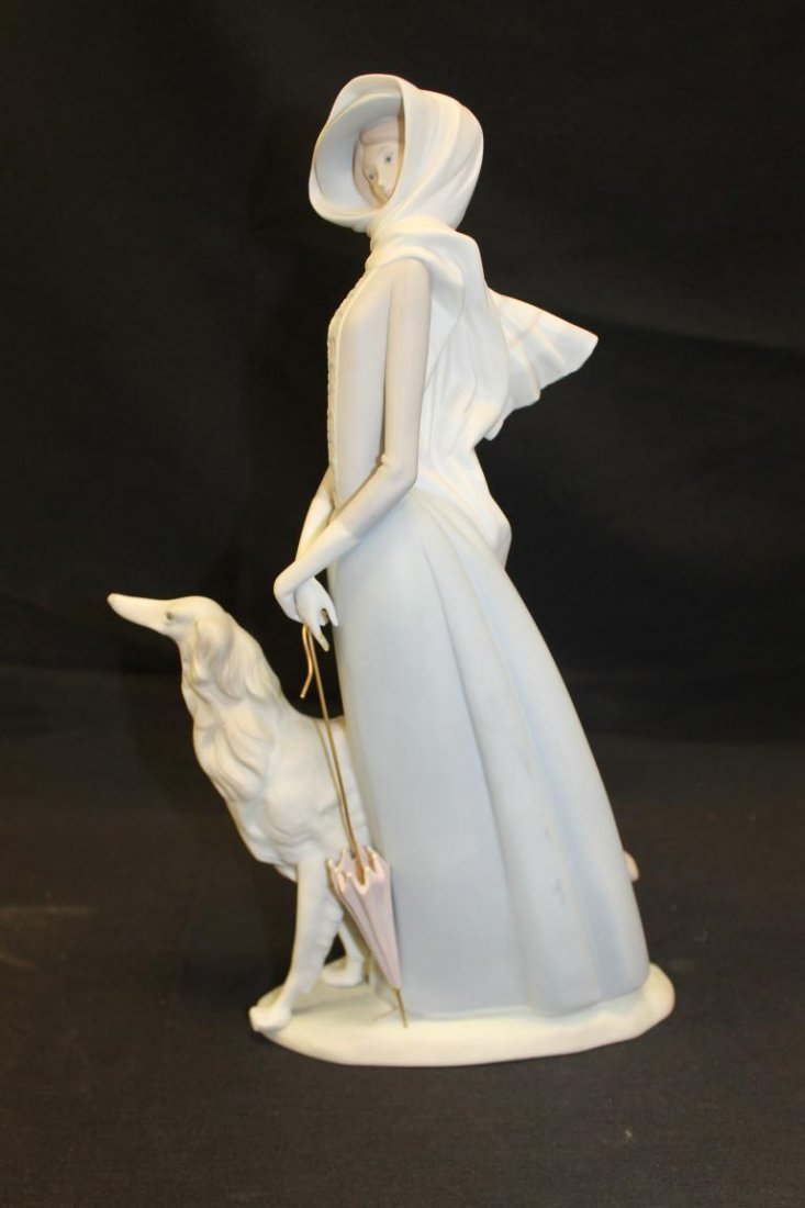 "Lladro figure of a lady with umbrella and dog, 15 3/4""."