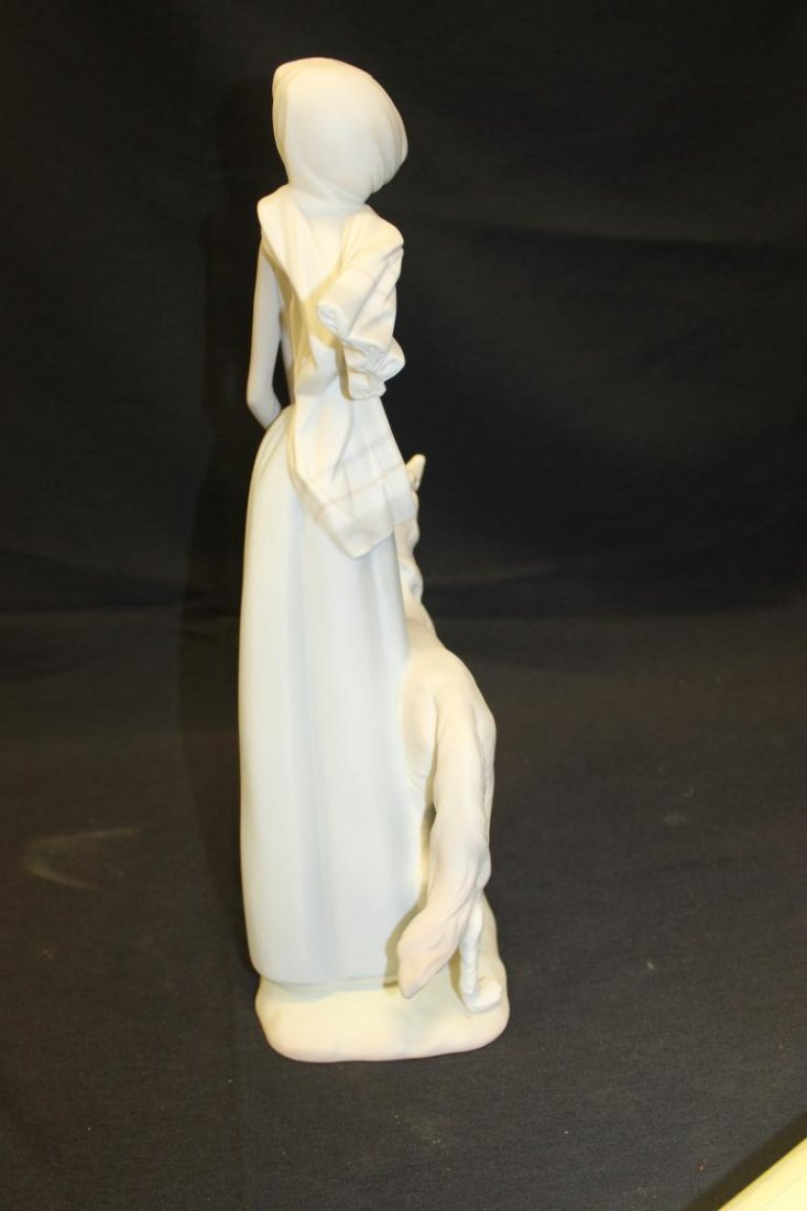 "Lladro figure of a lady with umbrella and dog, 15 3/4"". - 4"