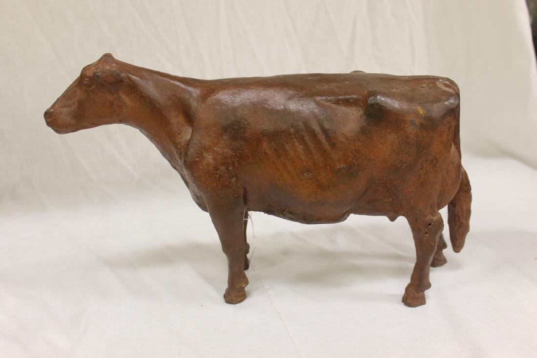 Well formed painted iron Guernsey cow with minor