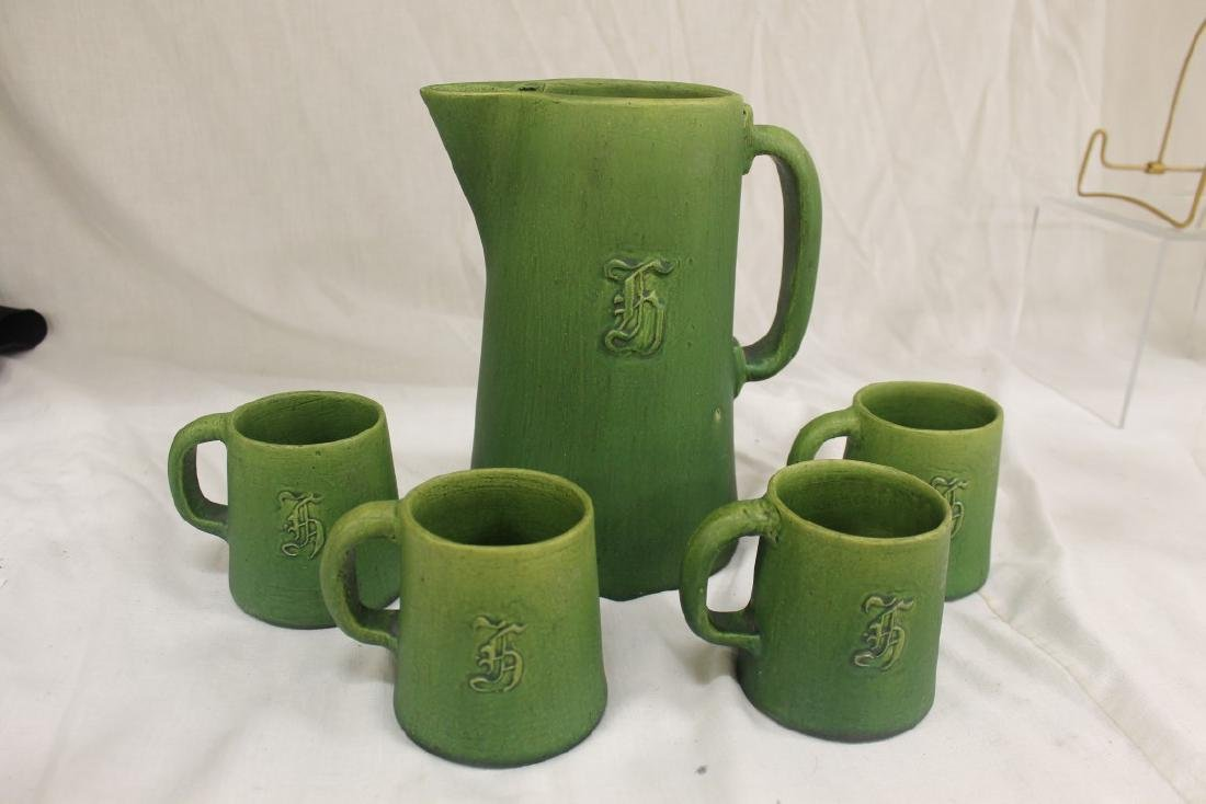 Acorn marked stonware tankard with 4 mugs with moled