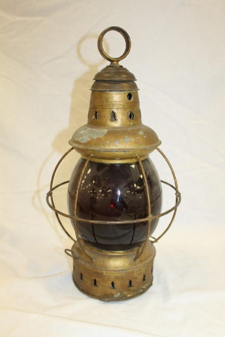 Painted tin lantern with deep ruby globe marked G. T.