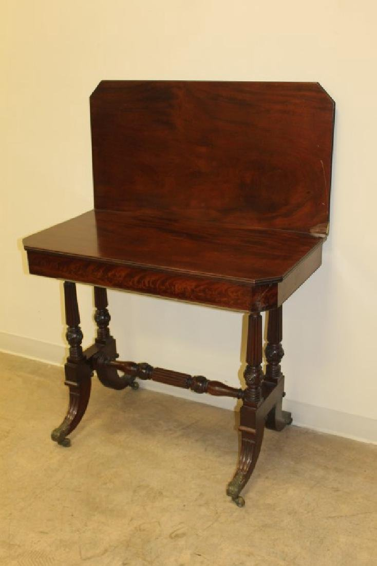 Carved mahogany game table with finely carved base with