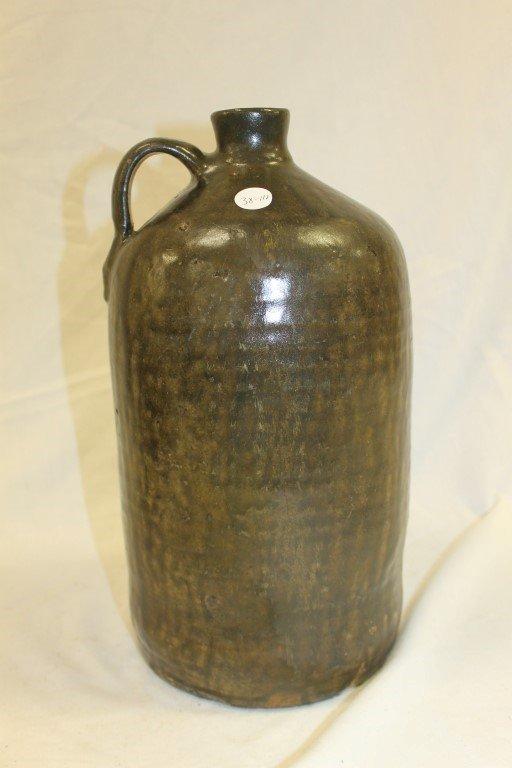 """Slip glaze tall Southern pottery jug with stamped """"JM"""""""