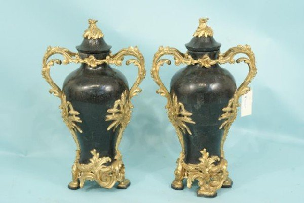 10: PAIR OF BLACK TILED MARBLE URNS WITH GILT TRIM