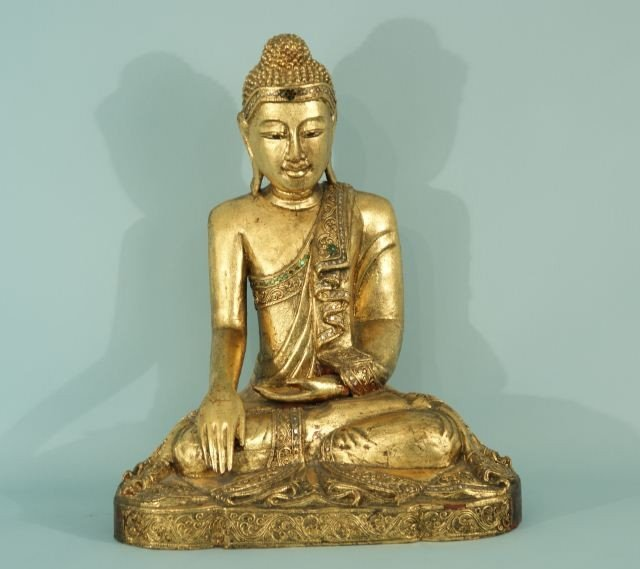 11: ANTIQUE ORIENTAL GILDED AND JEWELED BUDDHA