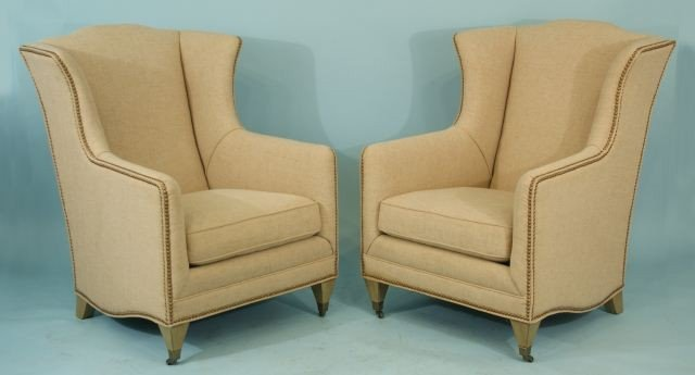 12: PAIR OF MID-CENTURY STYLE WING CHAIRS ON CASTERS