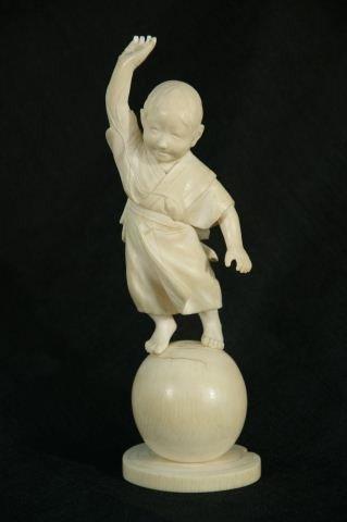 83: ANTIQUE JAPANESE IVORY SCULPTURE OF A PLAYFUL BOY