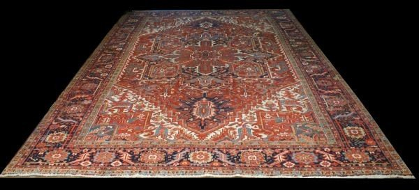 20B: HAND KNOTTED WOOL RUG IN NAVY, IVORY IN A RUST
